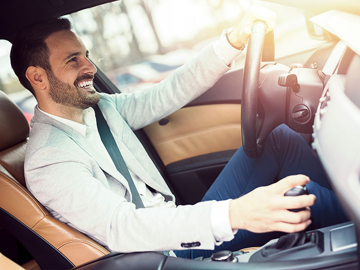 Man driving car full of energy