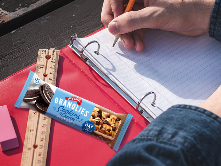 Student studying with a Granlolies Bar to boost his energy