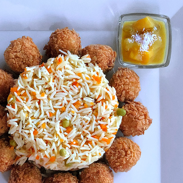 Fish Balls rolled in Cornflakes and served with Basmati Rice and Curry Sauce